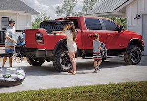 Family loading up 2020 RAM 1500 trunk
