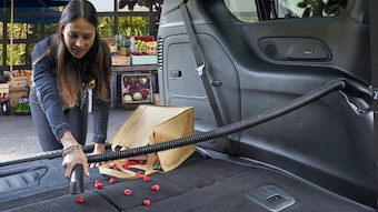 woman vacuuming in the back of the 2020 Chrysler Pacifica
