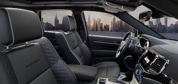 2021 Jeep Grand Cherokee front seating and dashboard