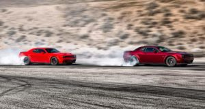 Two 2021 Dodge Challengers racing.