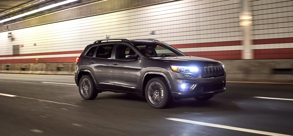 The 2021 Jeep Cherokee driving in a tunnel.